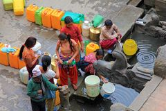 People at Sunken Manga Hiti with water containers for household use Stock Image