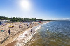 People on the sunny beach of Baltic Sea in Gdansk. GDANSK, POLAND - AUGUST 14, 2017: People on the sunny beach of Baltic Sea in Gdansk Brzezno. Gdansk is very Stock Photos