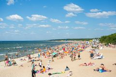 People on the sunny beach of Baltic Sea Royalty Free Stock Images