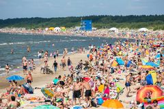 People on the sunny beach of Baltic Sea Royalty Free Stock Image