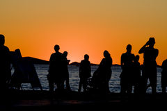 People at sunset. People by the sea at sunset in Zadar, croatia Royalty Free Stock Images