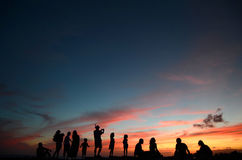 People At Sunset By The Beach. A Group Of People Enjoying A Sunset By The Beach In Hawaii Stock Photography