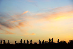 People and sunset clouds Royalty Free Stock Photography