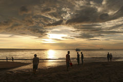 People in the sunset on Koh Lanta, Thailand Stock Image