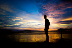 People with sunset and silhouette Royalty Free Stock Photo