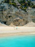 People suntanning at Egremni beach, Lefkada, Greece royalty free stock images