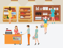 People in supermarket grocery store with shopping baskets. Royalty Free Stock Photos