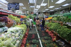 People in supermarket. New York, United States - 2 September 2016. People by vegetable racks in supermarket stock images