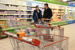 People in supermarket stock images