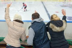 People supporting ice hokey team. Supporting stock photography