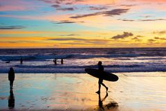 People surfer silhouette beach Bali royalty free stock image