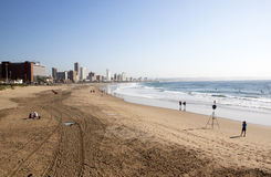 People and Surfers on Addington Beach in Durban Stock Photo