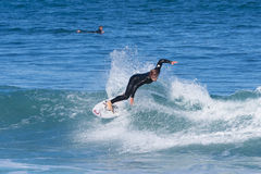 People surfing at a beach along the Great Ocean Road in Australia Stock Image