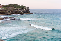 People surfing in the ocean at Bondi Beach in Sydney, Australia. Sydney, Australia - April 9, 2016: People surfing in the ocean at Bondi Beach in Sydney Royalty Free Stock Photography