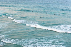 People surfing in the ocean at Bondi Beach in Sydney, Australia. Sydney, Australia - April 9, 2016: People surfing in the ocean at Bondi Beach in Sydney Stock Photos