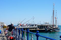 People on Swanage pier. Royalty Free Stock Image