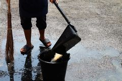 People are sweeping dirty water at ground streets, cleaner floor, housemaid, housekeeper, homemaker, maidservant, maid stock image