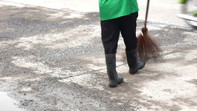 People are sweeping the streets stock video footage