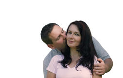 People - Sweet kiss. Man kissing woman. The skin was filtered to a achieve a smooth nice look Royalty Free Stock Photos