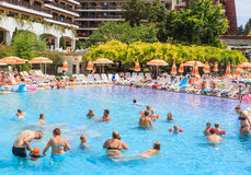 People swim in pool of hotel Flamingo Grand Hotel at summer. Albena, Bulgaria Royalty Free Stock Image