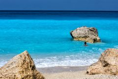 People swim in the sea at the Megali Petra Beach in Lefkada Isla. Nd, Greece Royalty Free Stock Images