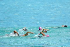 People swim the swimming stage of Raratonga triathlon contest Co Royalty Free Stock Photos