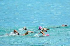 People swim the swimming stage of Raratonga triathlon contest Co. People swim the swimming stage of Raratonga triathlon contest. Triathlon competition involves Royalty Free Stock Photos