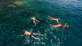 People swim in transparent azure sea near tourist boat. NHA TRANG, KHANH HOA/VIETNAM - SEPTEMBER 11 2015: Upper view people swim in transparent tranquil stock video footage