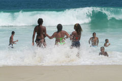 People swiming in the ocean waves. People swiming in huge the ocean waves at Rio de Janeiro beach, Brazil. Big dangerous ocean and seawaves, good for surfing Stock Photo