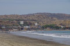 People swiming in Pacific ocean in Mancora surfer's beach Stock Photos