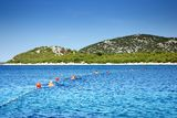 People swimming with buoys in a clean, warm sea, Croatia Dalmatia Royalty Free Stock Photo