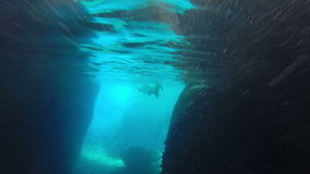 People swimming in cave, underwater shot, Bisevo island, Croatia stock video footage