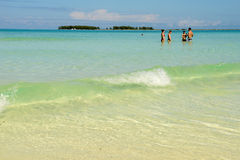 People swimming in clear water of Cayo Guillermo beach, Cuba Stock Photography