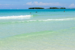 People swimming in clear water of Cayo Guillermo beach, Cuba Stock Images