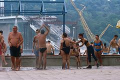People in swimming costumes by destroyed bridge, Serbia Royalty Free Stock Photos