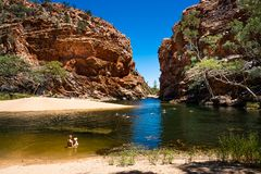 People swimming in Ellery creek big hole in the West MacDonnell Ranges NT outback Australia. 27th December 2018, NT Australia : People swimming in Ellery creek stock image