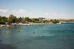 People swimming and kayaking at Andreas & Melani beach in a summer season, Cyprus Stock Photos