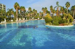 People swimming in the large pool in Turkish hotel Royalty Free Stock Images