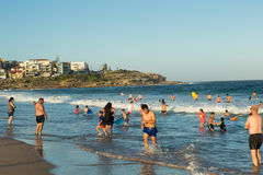People swimming at Maroubra beach. People and families swimming and having fun in summer time at Maroubra beach, Sydney Royalty Free Stock Photos