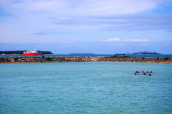 People swimming near port, Tonga Royalty Free Stock Photos