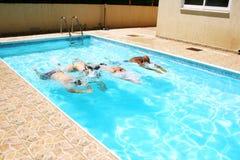 People in swimming pool. People having fun in  swimming pool Royalty Free Stock Photo