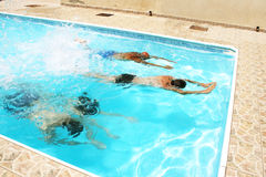 People in swimming pool. People having fun in  swimming pool Royalty Free Stock Photography
