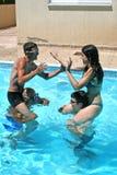 People in swimming pool. People having fun in  swimming pool Royalty Free Stock Photos