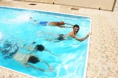 People in swimming pool. People having fun in  swimming pool Royalty Free Stock Image