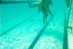 People at the swimming pool,  underwater photo of Stock Photography
