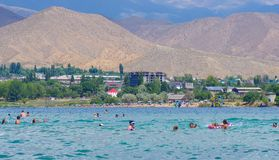 People relaxing during summer holiday in Kyrgyzstan. People swimming and relaxing during summer holiday near Cholpon-Ata, Kyrgyzstan 30.07.2017 royalty free stock images