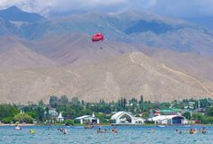People relaxing during summer holiday in Kyrgyzstan. People swimming and relaxing during summer holiday near Cholpon-Ata, Kyrgyzstan 30.07.2017 royalty free stock photos