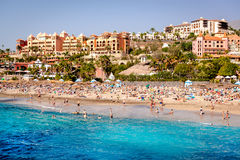 People swimming and sunbathing on the El Duque beach Royalty Free Stock Photo