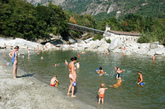 People swimming and sunbathing on maggia river at Ponte Brolla Stock Photo