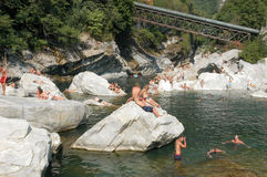 People swimming and sunbathing on maggia river at Ponte Brolla Royalty Free Stock Photo